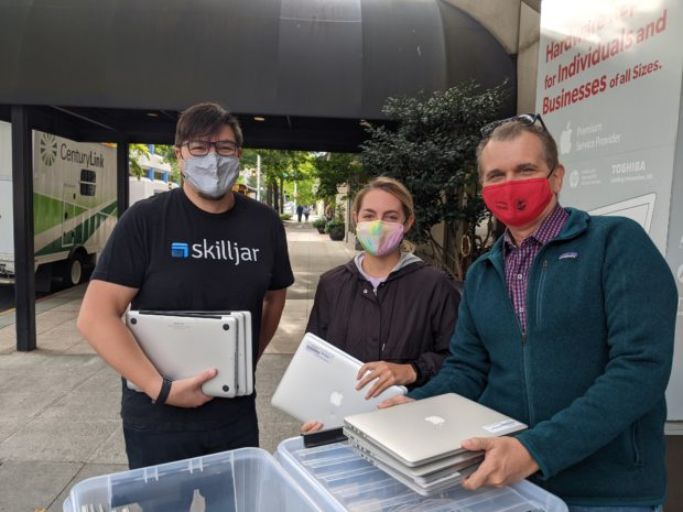 Skilljar employees donate computers to Northwest Education Access
